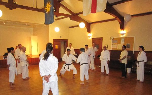 Students watch as Jim Sagawa (5th degree black belt) demonstrates a sparring drill